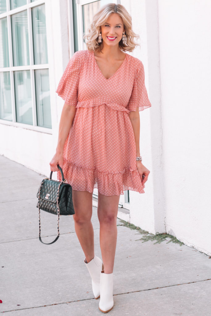 I love this cute pink polka dot dress paired with my white ankle boots for an easy fall transition outfit.