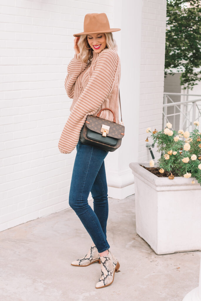 This chunky sweater is giving me all the fall feels! Pair it with a fun snakeskin boot to add some print.