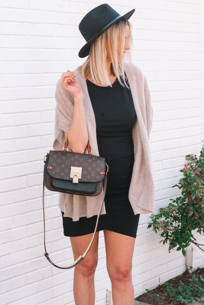 Ruched dress with a cashmere poncho over it