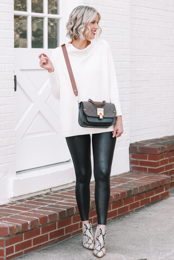 I love how this long white tunic sweater pairs with my leggings for the perfect faux leather leggings outfit!