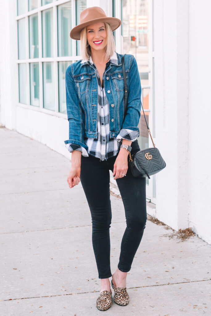 Black and white plaid shirt with jean jacket black jeans, and leopard shoes.