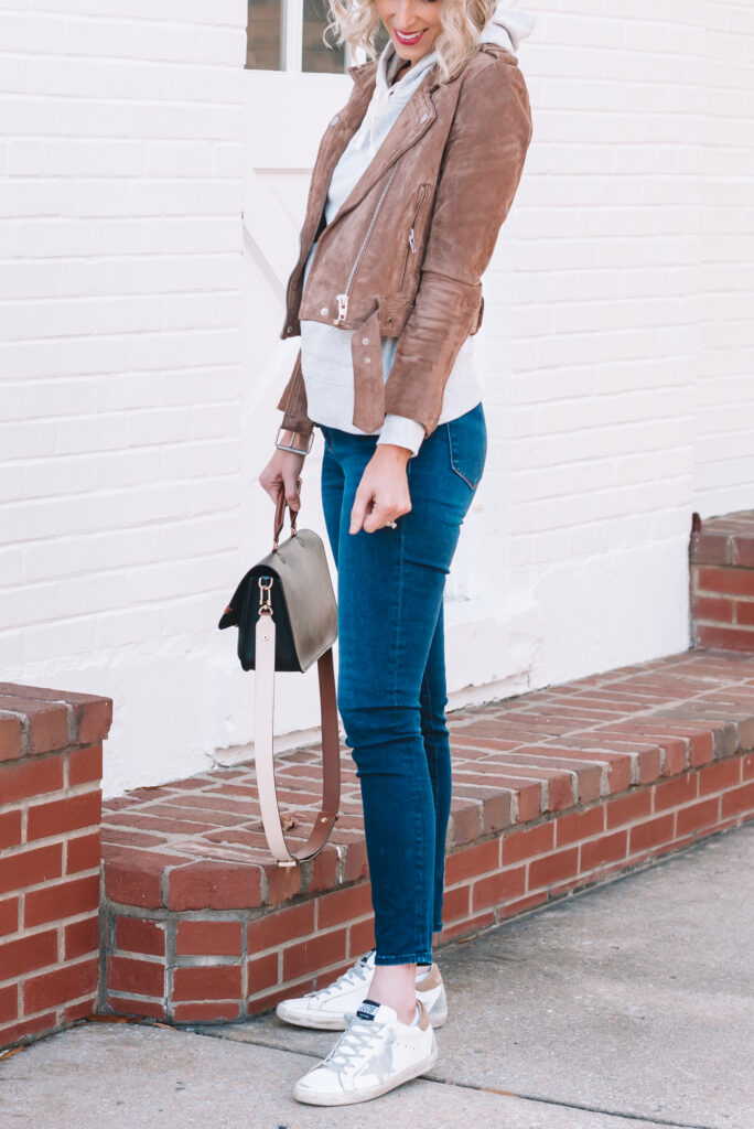 I love dressing up my sweatshirt with a fun suede moto jacket.