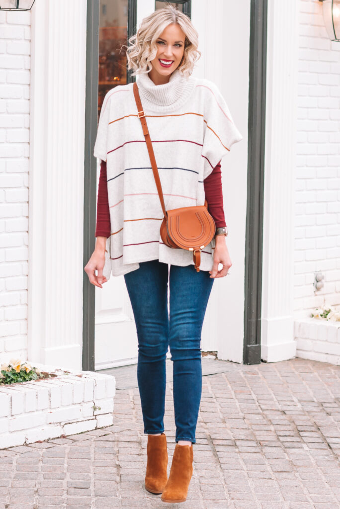 You can pair this striped poncho with jeans for a more casual look or put a fitted dress underneath it for a more dressy option.