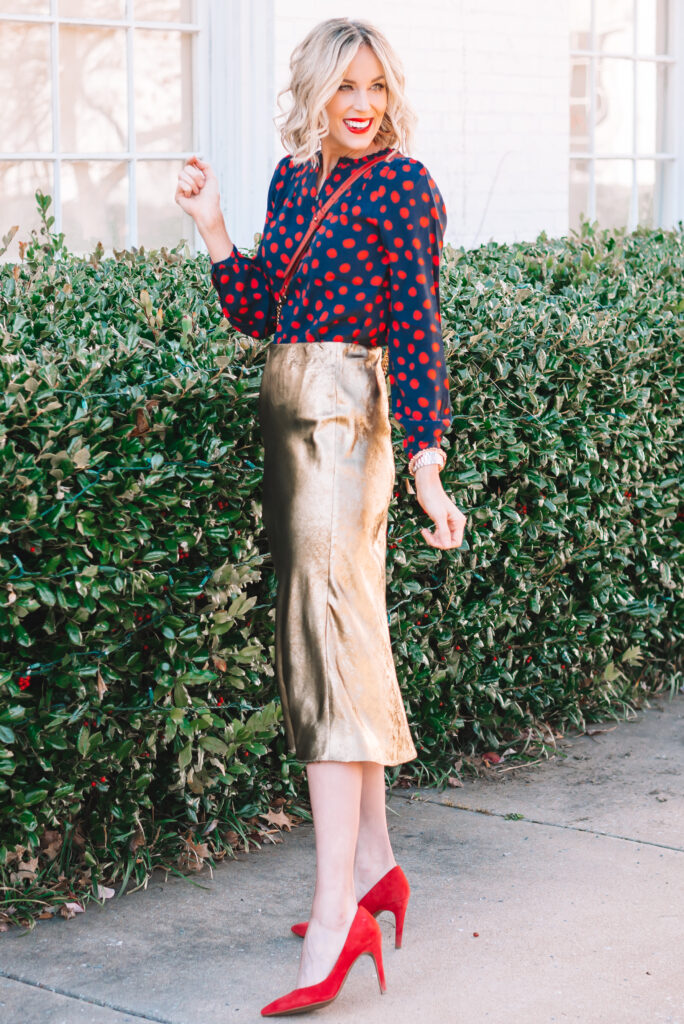 Match your heels to your blouse and pair with a fun midi skirt.
