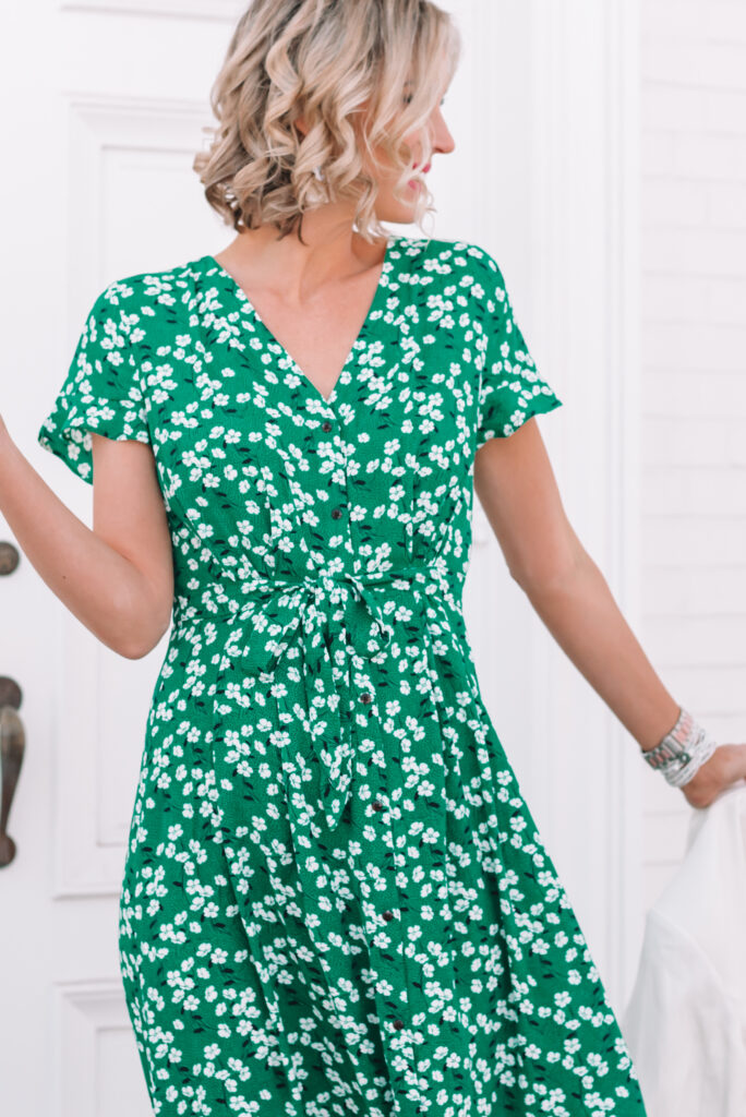 This gorgeous green spring midi dress is ultra flattering with a defined waist and tie detailing.