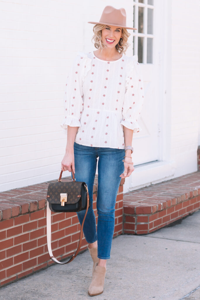 I am loving this under $30 Target embroidered ruffle top for spring! It has boho Free People vibes but for way less!