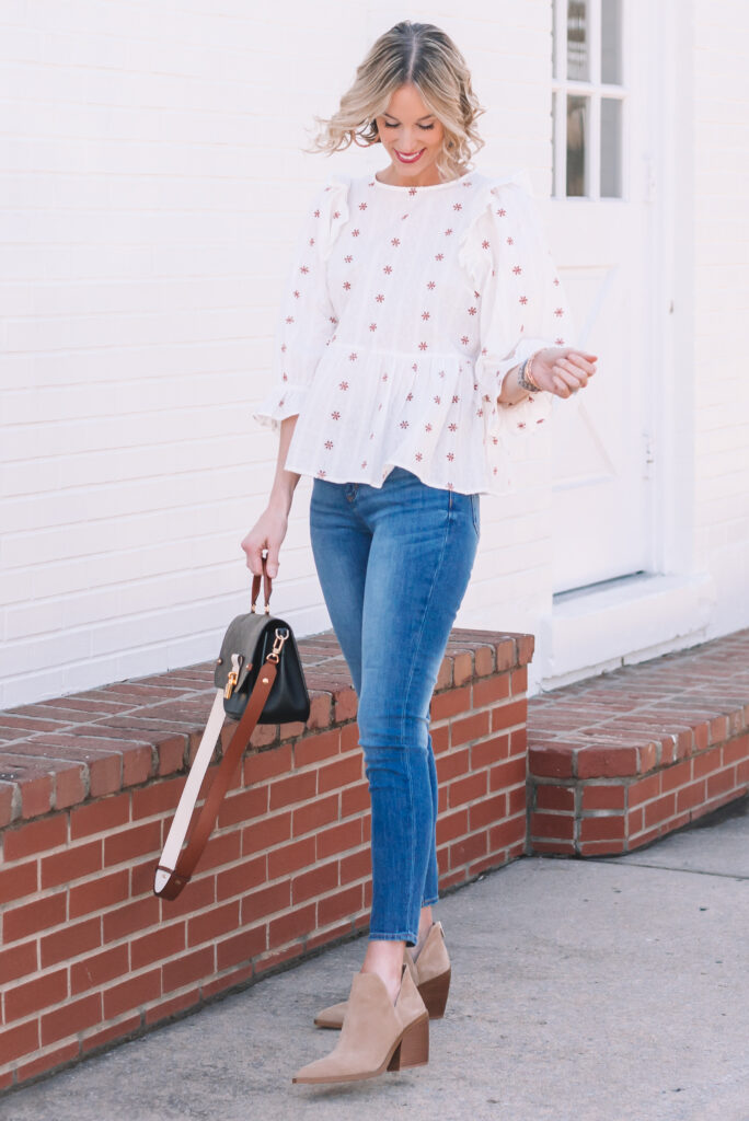 This boho embroidered ruffle top is perfect for spring with jeans and booties!