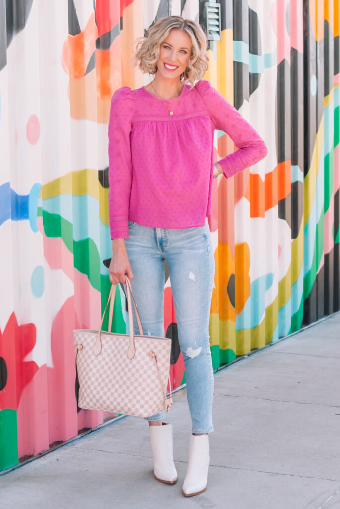 I love this gorgeous pink top paired with white boots for a spring feeling outfit that will still keep you warm.