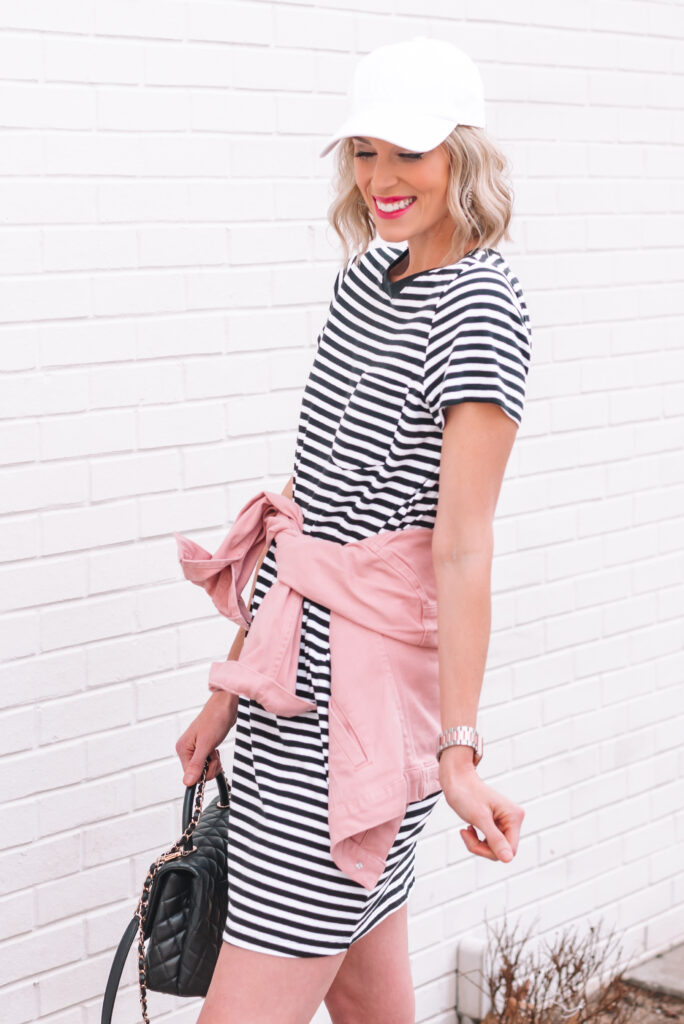 This black and white striped t-shirt dress is just $10 and is the best closet staple! Click to read 6 ways to style it in all seasons.