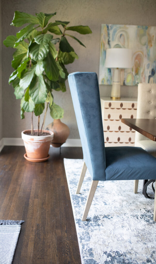 These blue velvet performance fabric  dining room host chairs are not only perfect for our transitional eclectic style but also perfect for our family's lifestyle.