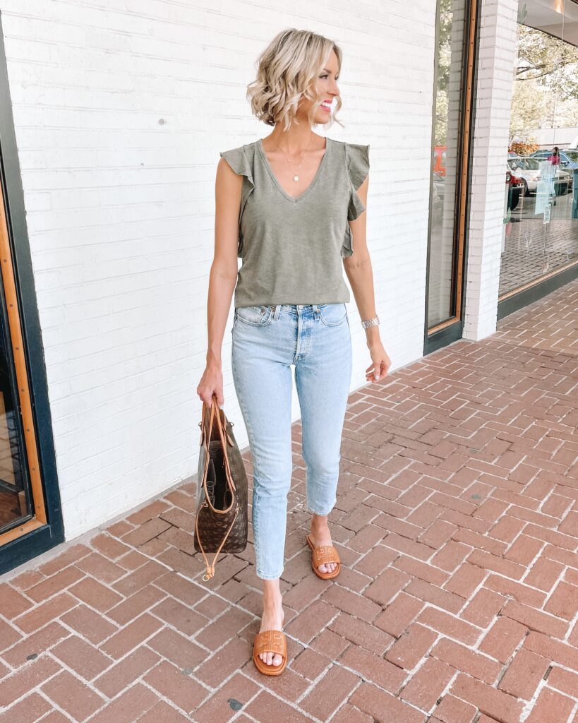 This is my spring uniform! Cute t-shirt, easy jeans, and comfy slides!