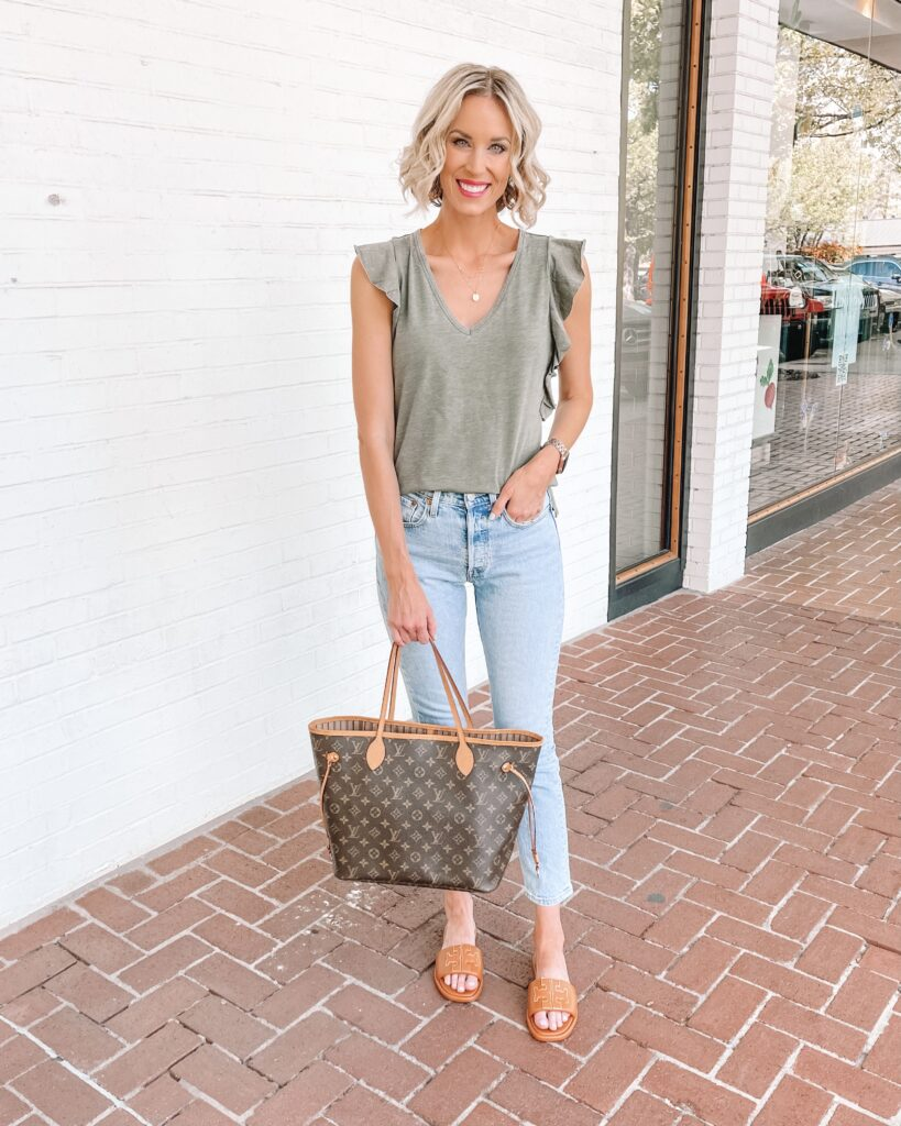 I am loving these Levi's jeans paired with the new Tory Burch Double T Sport Slides and a cute t-shirt with ruffle details!