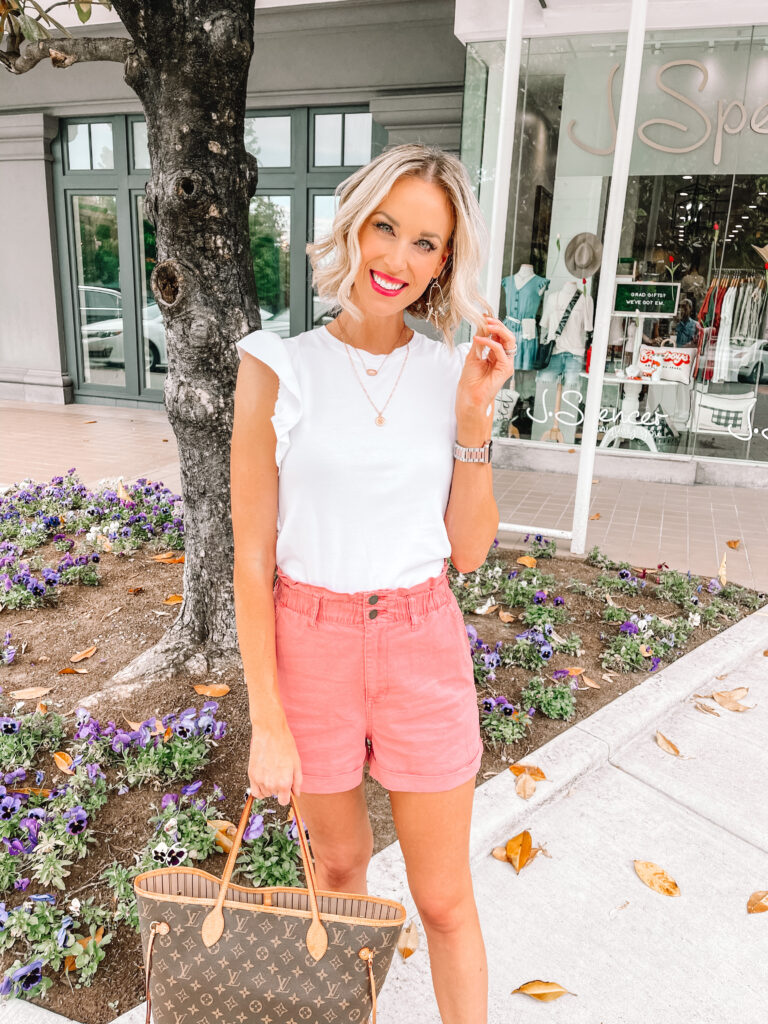 I paired my pink gathered waist shorts with a simple white ruffle sleeve tee and gold jewelry for an easy and cute summer outfit!