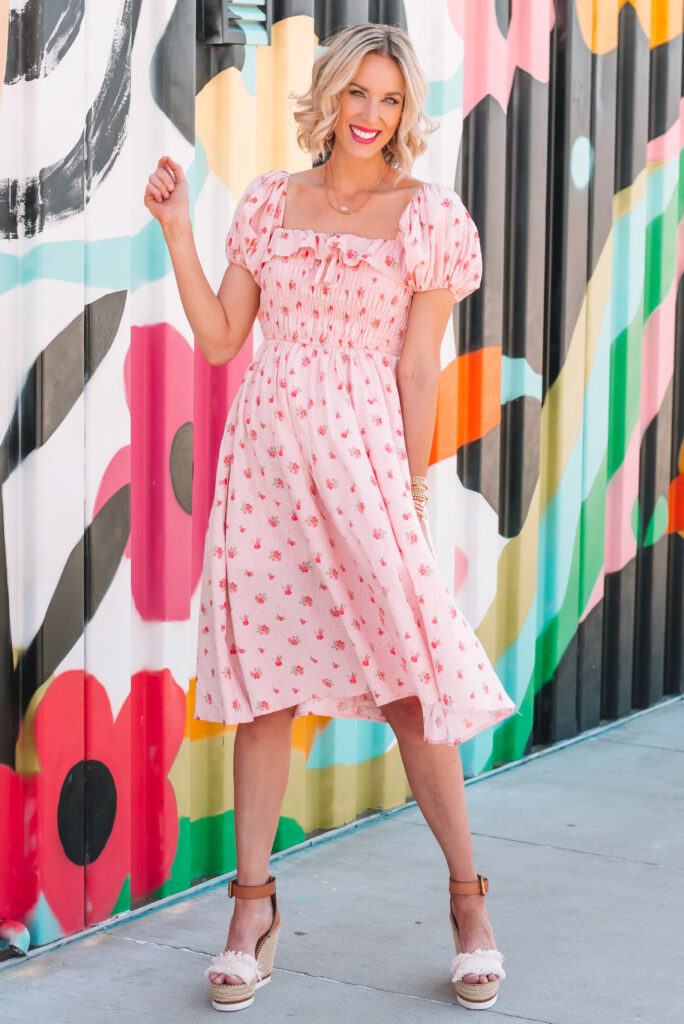 This smocked ruffle top dress is the perfect summer wedding guest dress! It's just $32 and can be worn off the shoulder too.