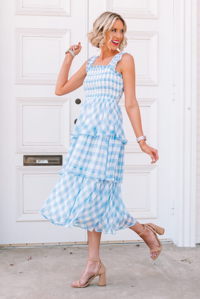 You'll want this blue gingham midi dress for any events you have this summer.