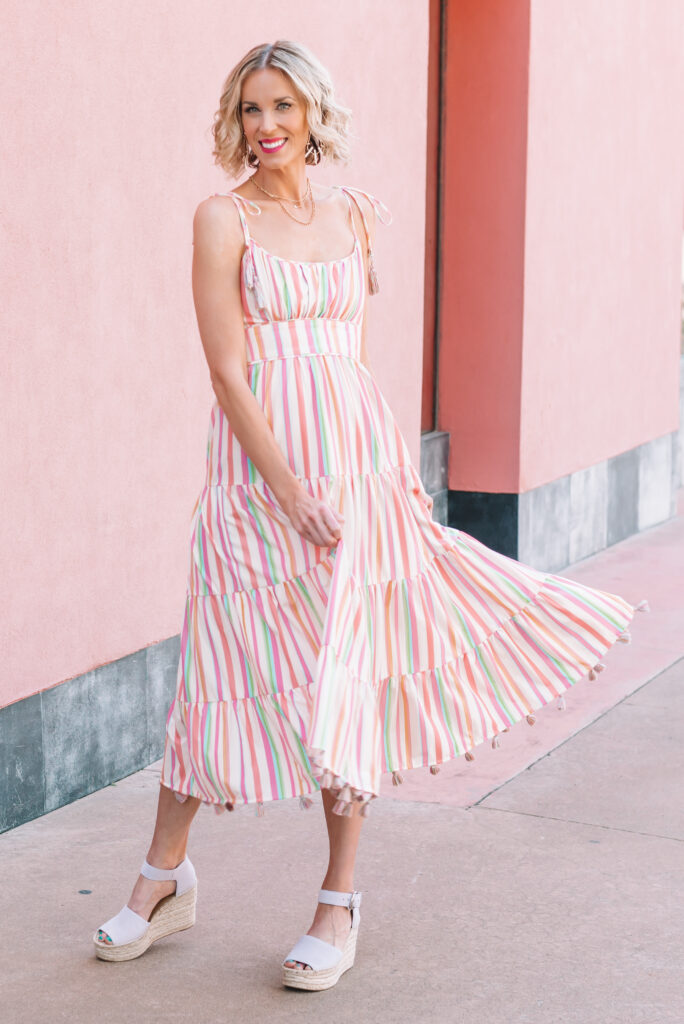 Love this rainbow stripe dress for summer! The shoulder tie and tassels are so fun!