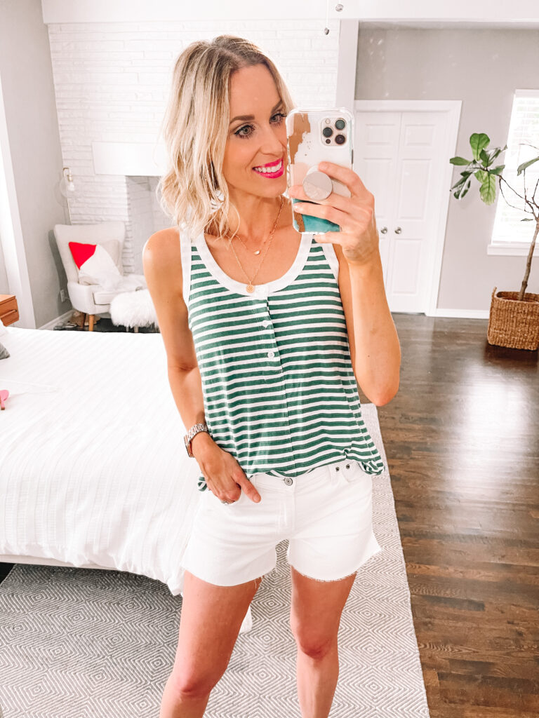 This striped henley tank is perfect for a casual outfit with my jean shorts. Click to see more  white jean shorts outfit ideas.