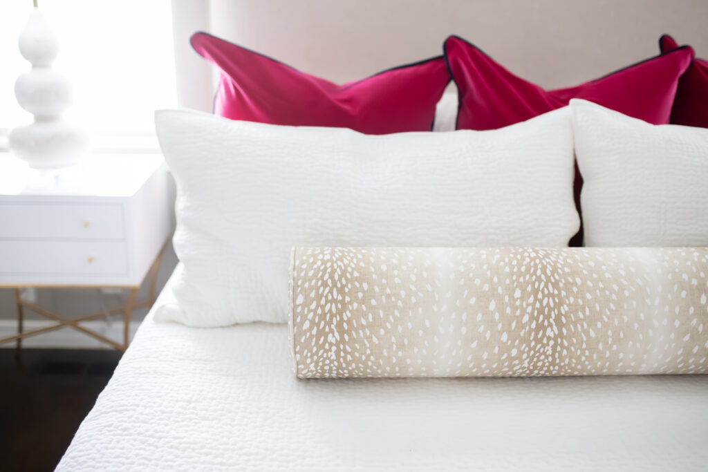 This bedding could not be more perfect! I love the magenta pillows with the antelope bolster.