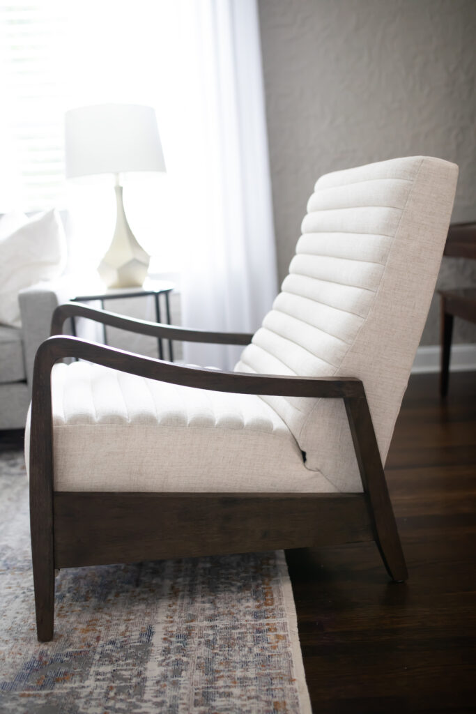 Would you ever guess this mid-century modern cream fabric chair is actually a modern recliner?