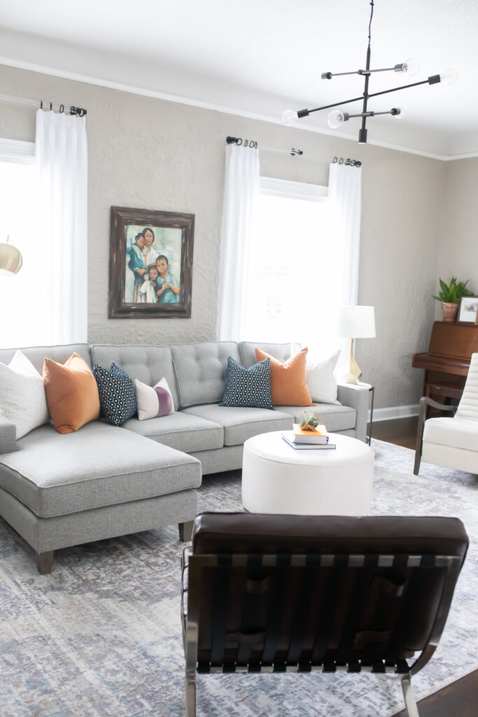 I'm beyond excited to reveal our transitional living room update with Luxe Furniture & Design Tulsa. It's everything we ever wanted and more with the comfy, large sectional with performance fabric, kid friendly coffee table, modern recliner, and more.