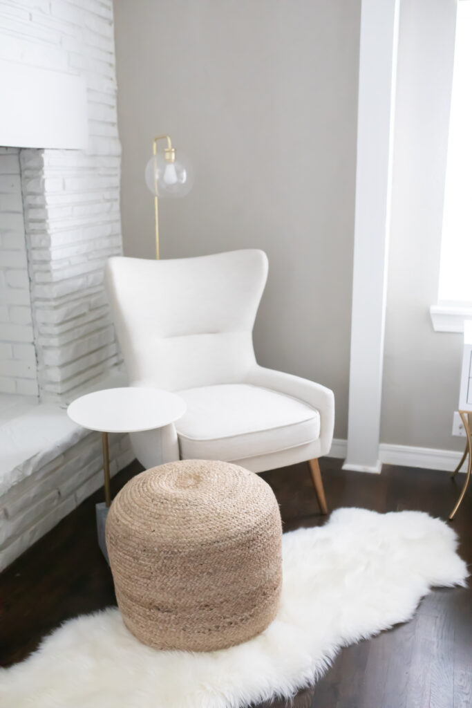 I love this little seating area in our transitional eclectic master bedroom!