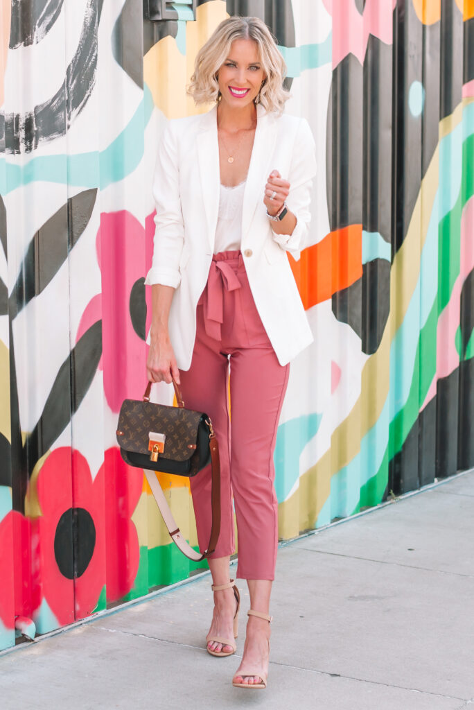 I love these Amazon paper bag waist work pants in the pink color. They are such a fun change from your traditional work pant and pair perfectly with a white blazer.
