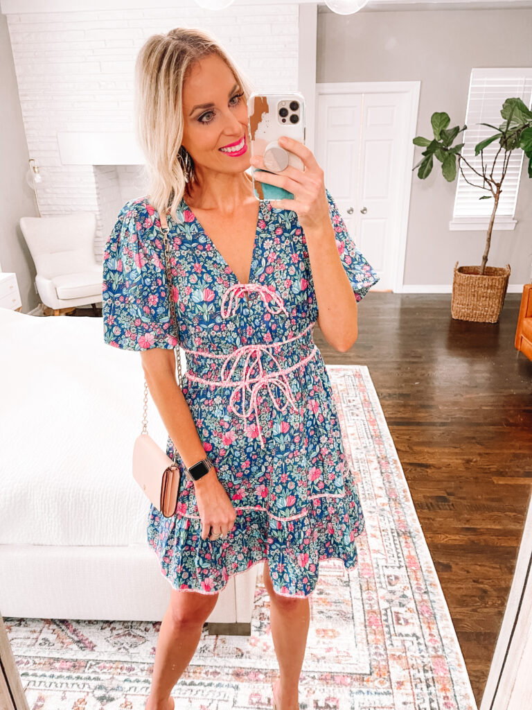 I love this gorgeous blue floral dress paired with my gold heels for a summer wedding guest dress.