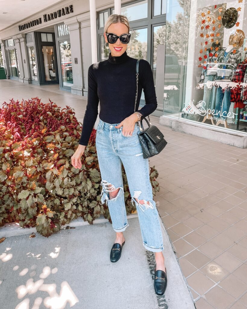 I am loving this black turtleneck bodysuit paired with my favorite distressed jeans and mules for a classic fall look.