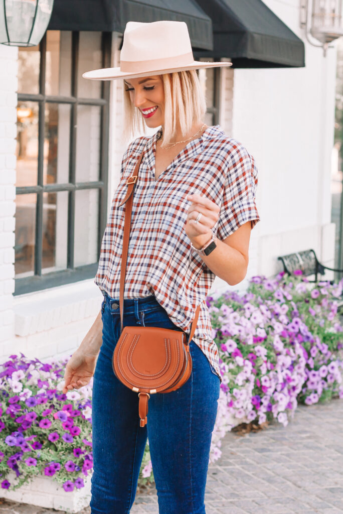 I am loving this light weight short sleeve plaid shirt for an easy fall transition outfit idea! You can wear it now with jeans and mules or boots and later with any layer of your choosing!