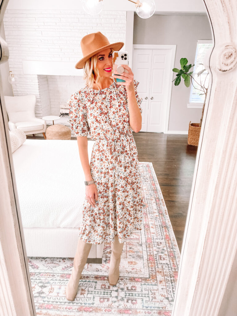 I love this floral dress for just $33! You can wear it now with sandals or later with boots as shown. Get the link and more in my Walmart fall try on haul.