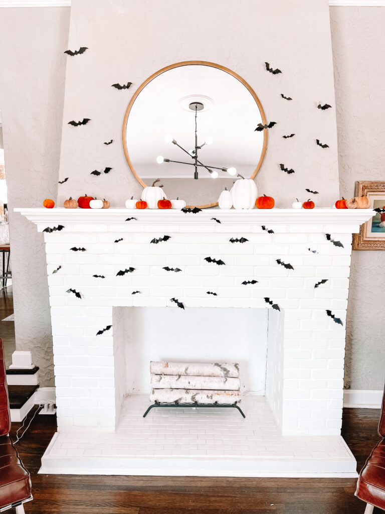 Looking for affordable fall decor? I transformed my mantle for Halloween for $50 with these $7 stick on bats and cute faux pumpkin sets.