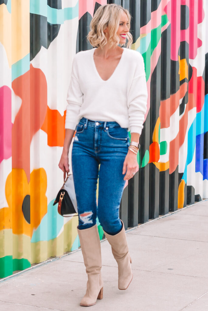 A white sweater is a wardrobe classic and today I'm sharing a white sweater for fall styled 3 ways! Each totally different and equally great! I love it with classic skinny jeans and tall boots.