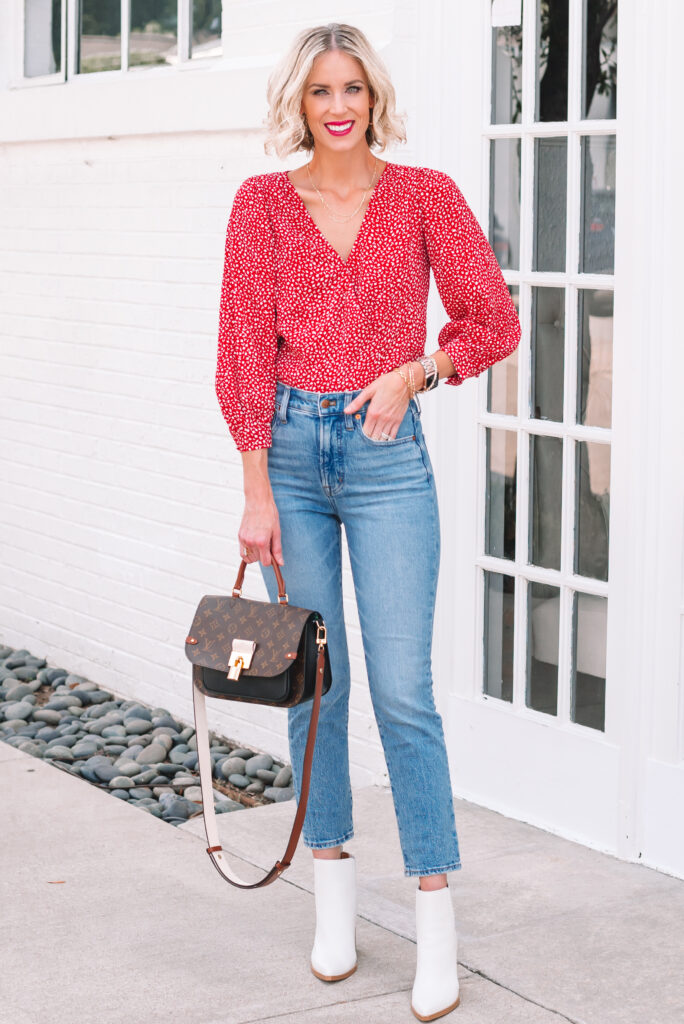 Are you looking for the perfect slim straight jean? Then you'll want to read this perfect vintage jeans by Madewell review! I love how they pair with these white boots and fun printed red blouse.