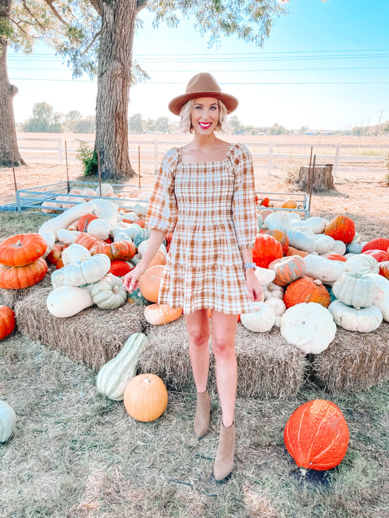 You'll be ready for fall in this adorable smocked plaid dress with the muted colors.