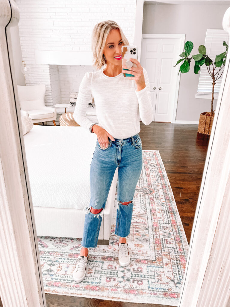 Wondering how to wear straight leg jeans? Today I am sharing 6 straight leg jean outfit ideas that you can easily implement in your closet! Pairing a dressier t-shirt tucked in with sneakers is an easy and casual look!